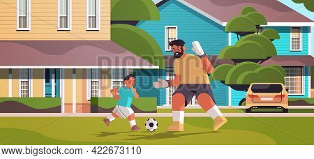 Father Playing Football With Son On Backyard Lawn Parenting Fatherhood Concept Dad Spending Time Wit