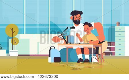 Young Father Helping Son Doing Homework Parenting Fatherhood Friendly Family Concept