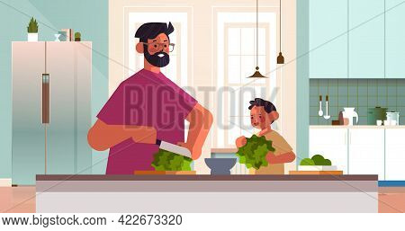 Young Father And Little Son Preparing Healthy Vegetables Salad At Home Kitchen Parenting Fatherhood