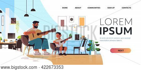 Young Father Teaching Little Son To Play The Guitar At Home Parenting Fatherhood Concept Living Room
