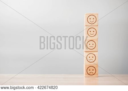 Emotion Face Symbol On Wooden Blocks. Service Rating, Ranking, Customer Review, Satisfaction, Evalua