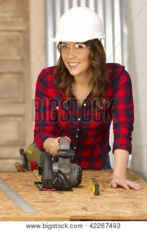 Woman Works On A Bench Cutting A Board