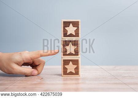 Man Hand Holding Star Block. Customer Choose Rating For User Reviews. Service Rating, Ranking, Custo