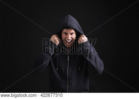 Portrait Of Emotional Man On Black Background. Personality Concept