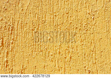 Painted Yellow Concrete Wall Background For Design Use, Close Up With Copy Space For Text Texture Ye
