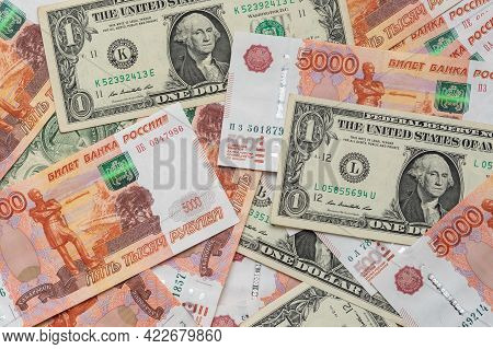 Backgrounds Of One Dollar And Five Thousand Rubles Cash Banknotes. Business Concept