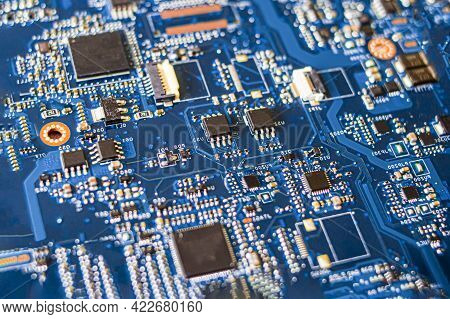 Blue Laptop Main Board With Micro Electronic Elements, Chips, Transistors
