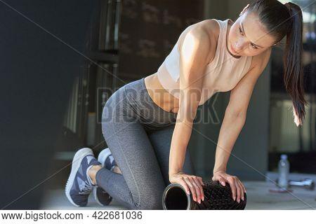 Fit Young Woman Doing Stretching Exercises Workout At The Gym. Fitness Female In The Gym Doing Abs E