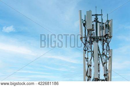 Telecommunication Tower With Blue Sky Background. Antenna. Radio And Satellite Pole. Communication T