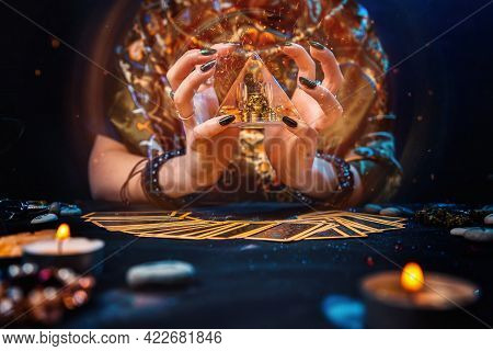 Sorcery. The Witch Held A Glowing Pyramid In Her Hands And Conjured It. The Tarot Cards Were On The