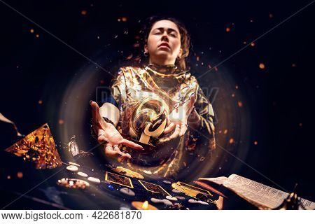 Portrait Of A Tense Witch Conjuring A Magic Energy Ball With Her Hands. The Concept Of Astrology, Ma