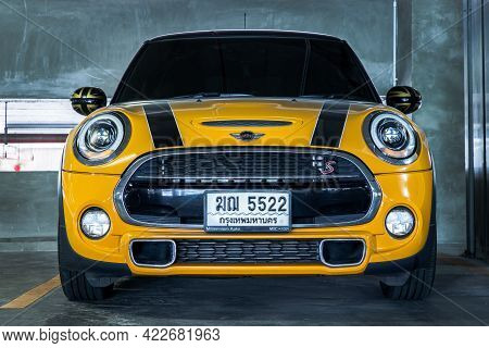 Bangkok, Thailand - 27 May 2021 : Front View Close Up Shot Of Yellow Mini Cooper Parked In The Parki