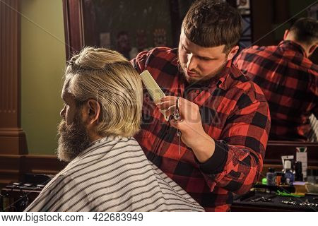 Barber Hairstyle Barbershop. Hipster Getting Haircut. Sharp Object Near Face And Squirming Distracts