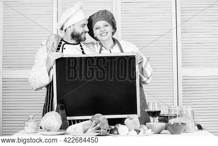 Family Values. Share Joy. Man And Woman Chef Cooking Food Together. Couple With Blackboard For Adver