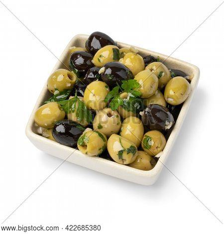 Bowl with green and black olives seasoned with garlic and herbs isolated on white background