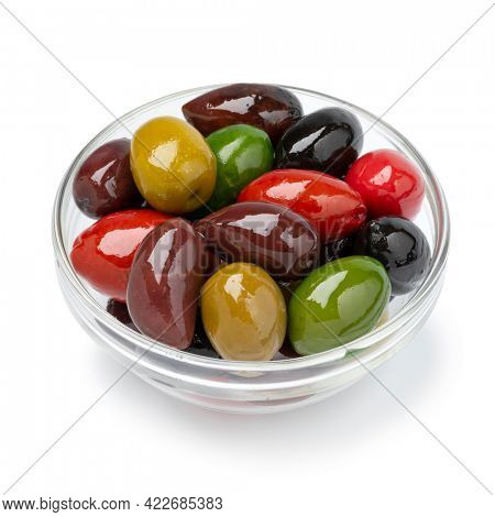 Glass bowl with a variation of different olives close up for a snack isolated on white background