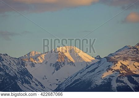 Rocky Mountain Range In Late Afternoon Sunlight, Northern British Columbia Canada.