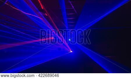 Blurry Background With Laser Blue Lights Of A Disco, Dance Floor.