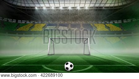 Composition of football on football pitch with spotlights and brazilian flag in sports stadium. championships, sports and competition concept digitally generated image.