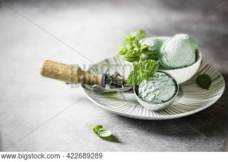 Homemade Mint Ice Cream With Mint Leaves On A Concrete Background.