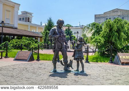 Simferopol, Crimea - July 15, 2020: Monument To Polite People. It Shows Soldier, Girl With Flowers A