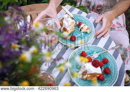 Girls Eating Cake In The Garden