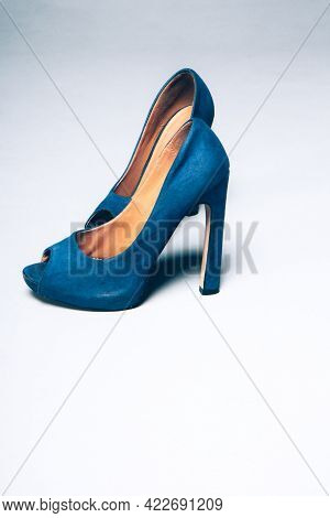 Womens Blue Worn Shoes High Heels On Gray Background. After Party, Fashion Concept. Side View