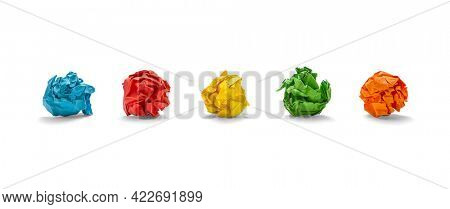 Colorful crumpled sheets of paper on white background