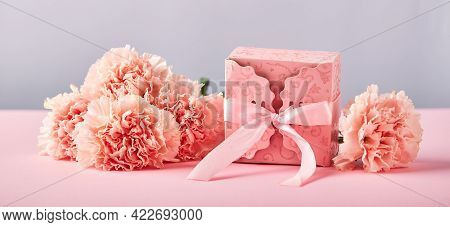 Bouquet Of Pink Carnations And Pink Gift Box. Design Concept Of Holiday Greeting With Carnation Bouq