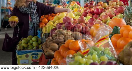 Selective Focus Woman Choose Fruit At Fresh Produce Local Market. Counter Of Street Market Stall Wit