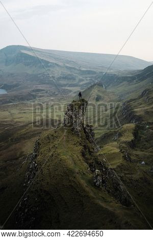 Female mountain climber at Quiraing on the Isle of Skye in Scotland