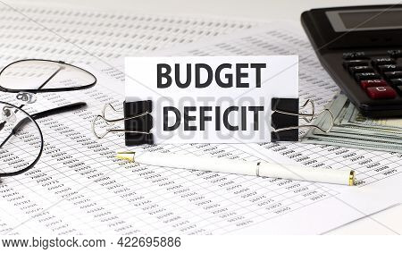 Word Writing Text Budget Deficit On White Sticker On Chart Background. Business