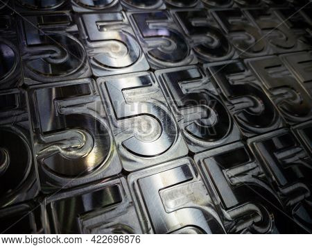 Shiny Metal Machined Digit 5 Plates Tiled Tightly - Full Frame Background