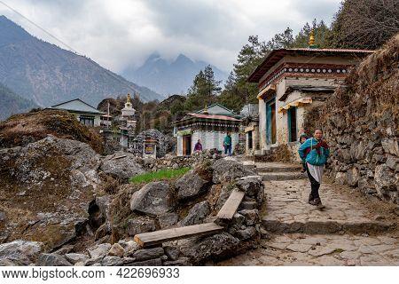 Tibetan Women On A Trail