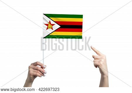 A Beautiful Female Hand Holds A Zimbabwe Flag To Which She Shows The Finger Of Her Other Hand, Isola