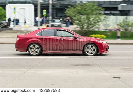 Moscow, Russia - May 2021: Red Honda Accord Eighth Generation Car Driving Fast On The Open Road