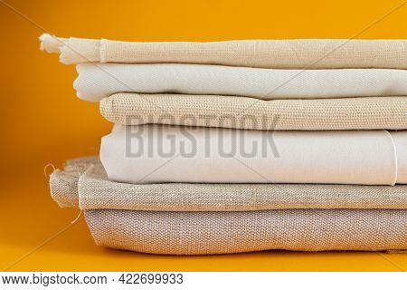 Natural Fabrics Of Ivory Color - Linen And Cotton Are Stacked In
