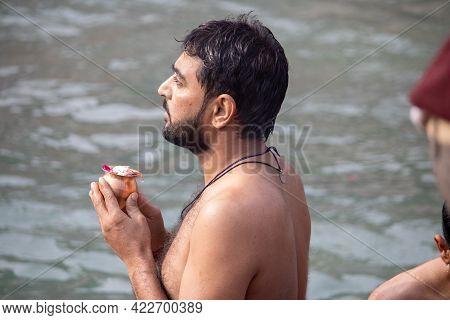 Haridwar, Uttarakhand, India, April 14, 2021.indian Man Worship Holy River The Ganges At Haridwar Ci