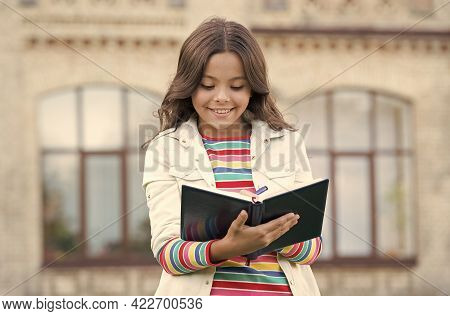 Writing A Diary. School Pupil Do Writing Task Outdoors. Happy Child Write In Copybook. Making Notes.