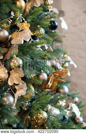Christmas Decorations With A Christmas Tree And Garlands For The Living Room In Gold Tones, Vertical