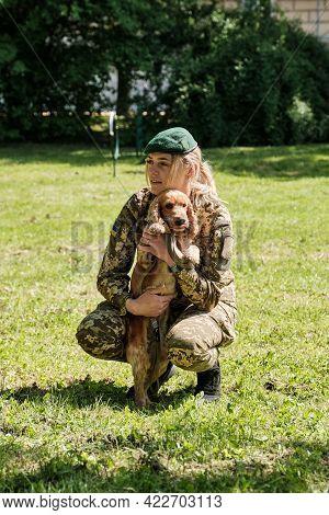 Cynologist With A Dog. Service Dog Breed English Cocker Spaniel Dog.