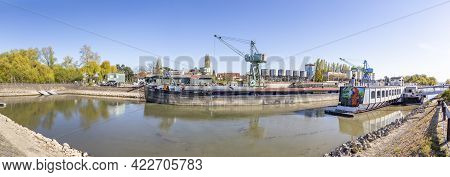 Ingelheim, Germany - April 26, 2021: Ship Wharf In Ingelheim At River Rhine With Crane And Pier.