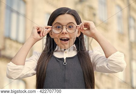For Smart Look. Happy Child Put On Glasses. Back To School Look. Vision Examination. Eye Sight Test.
