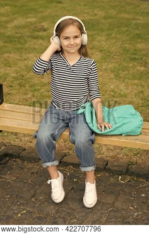 Listen Everywhere. Little Kid Listen To Music Summer Outdoors. Listen Technologies. Wireless Headpho