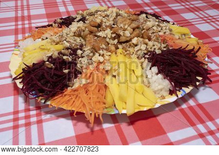 A Salad Of Grated Vegetables Neatly Laid Out On A Plate.