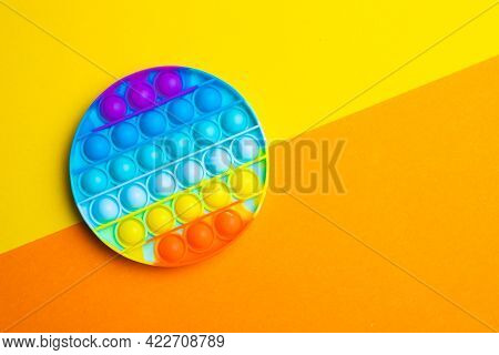 Pop It Anti-stress On A Colored Background. Modern Toys. Toys For Children. Silicone Game. Autism. T