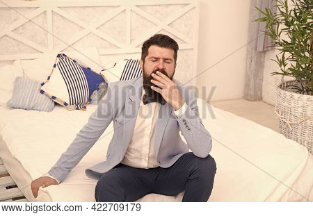 Tired Of Waiting. Elegant Man Yawn Sitting On Bed. Bearded Man In Classy Style. Fashion Look Of Groo