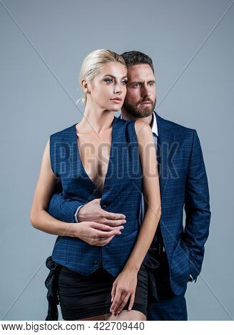 Formal Fashion. Confidence. Elegant Formal Couple Embrace. Couple In Love.