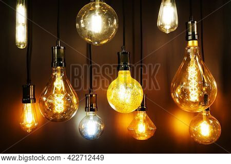 Modern Led Lamps In Retro Style. Bright, Colorful Lights Hang In An Electrical Store