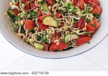 Salad With Vegetables And Microgreens, Sprouts Of Cereals And Broccoli, Tomatoes, Cucumbers, Oil, Sa